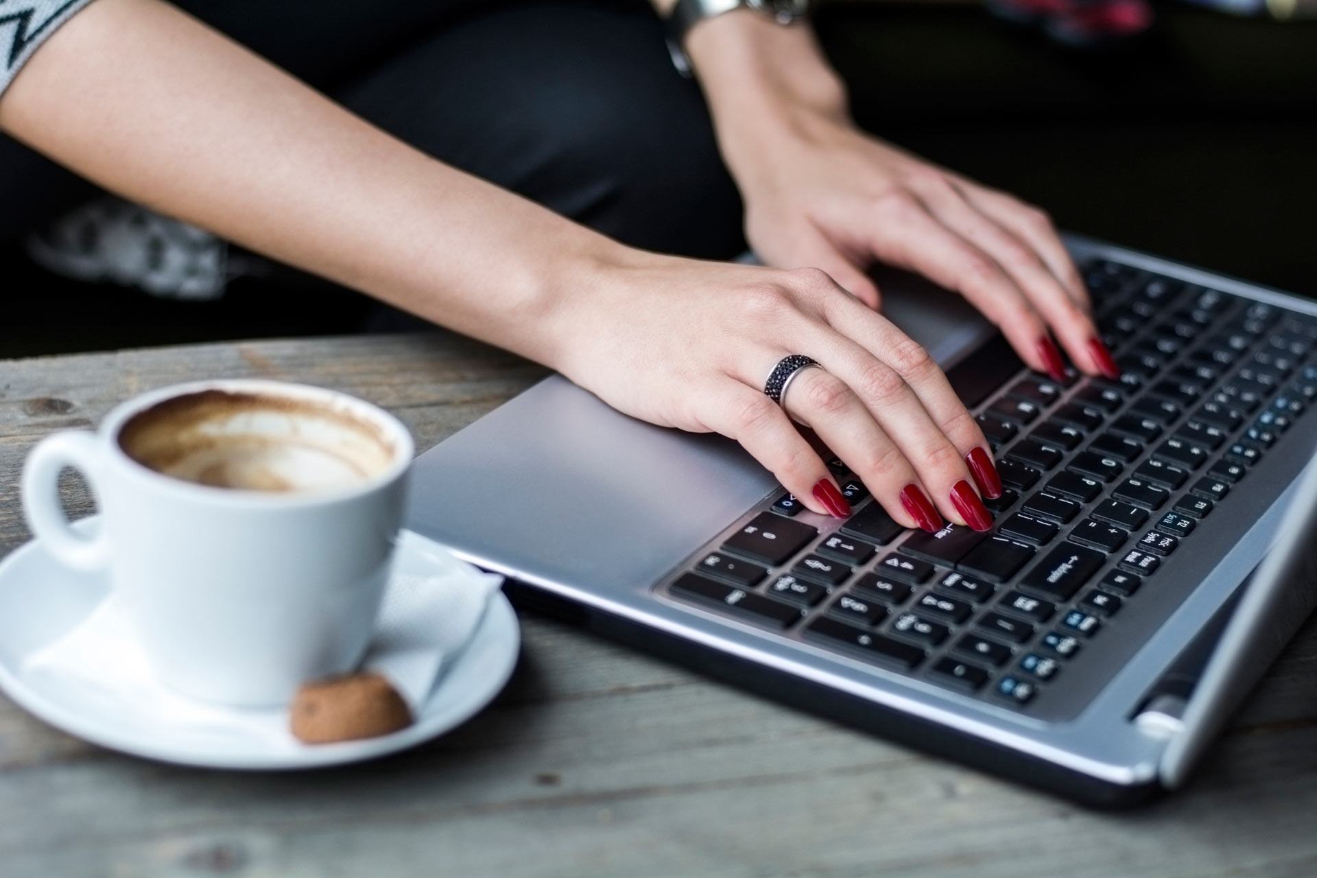 adult-health-best-adhd-blogs-article-4842-woman-typing-laptop-ts