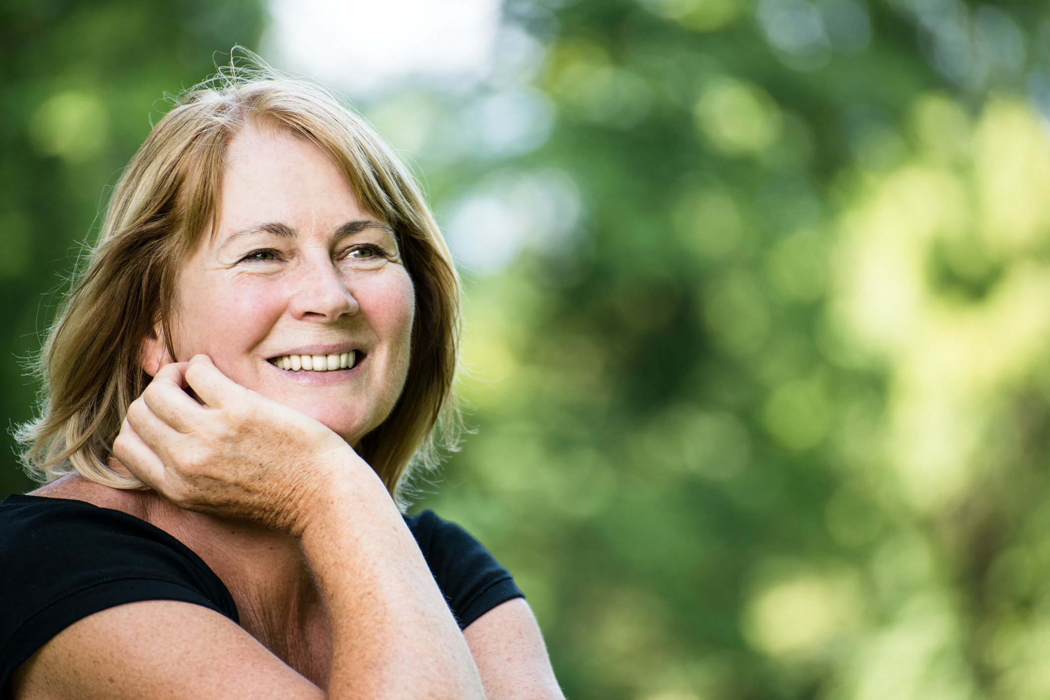 smiling mature woman outdoor portrait – additude
